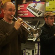 Greg and Tim Ryan perform duets for a Music and Arts open mic night in 2011.