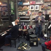 Greg joined trumpeter Griff Kazmierczak to play at a Music and Arts open mic night in 2014.