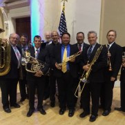 In 2014, Greg performed at the Johns Hopkins School of Advanced International Studies Commencement. (left to right; Ed Goldstein, Rob Mesite, Joey Bello, Ron Freidman, Greg Small, Frank Gorecki, Jari Villanueva, Jay Ellis, Jeff Stockham, Andrew Houde)