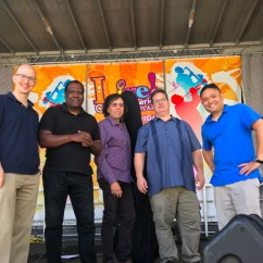 Greg performed with the Grasso-Ravita Jazz Ensemble in September of 2021 in DC at the Ronald Reagan Building's Woodrow Wilson Plaza. As part of the Live! Concert Series on the Plaza lineup, the group played music from its debut recording, Jagged Spaces. (left to right; Greg Small [piano], Benny Russell [sax], Phil Ravita [bass], Skip Grasso [guitar], Nucleo Vega [drums])