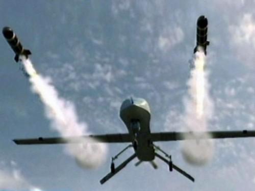 A predator drone firing missiles.