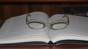 Picture of glasses on a book