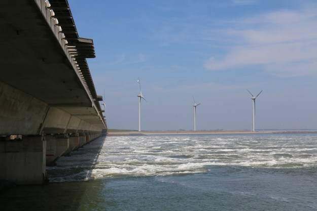 The storm surge barrier, gates up, with the tide rushing in from the North Sea. And (of course) a wind farm.