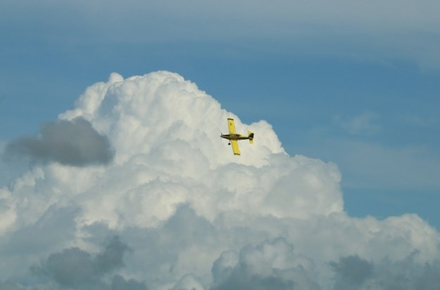 Crop duster and a cumulonimbus tower