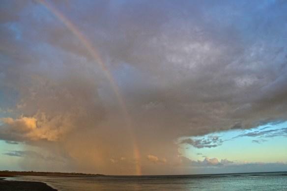 A rainbow in a rain cell, dawn, Hervey Bay