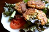 Crab cakes salad with sweet onion and poppyseed dressing.