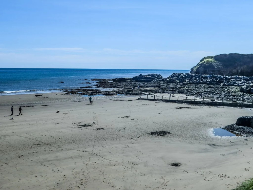 View of the wide open expanse of Sean beach - the perfect spot for sea glass hunting or just walking with the dog!