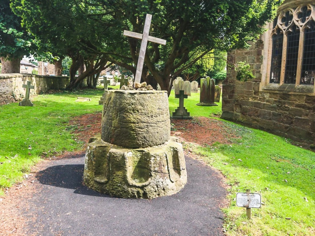 The ancient weeping cross at All Saints Church, Ripley Village, Yorkshire, UK