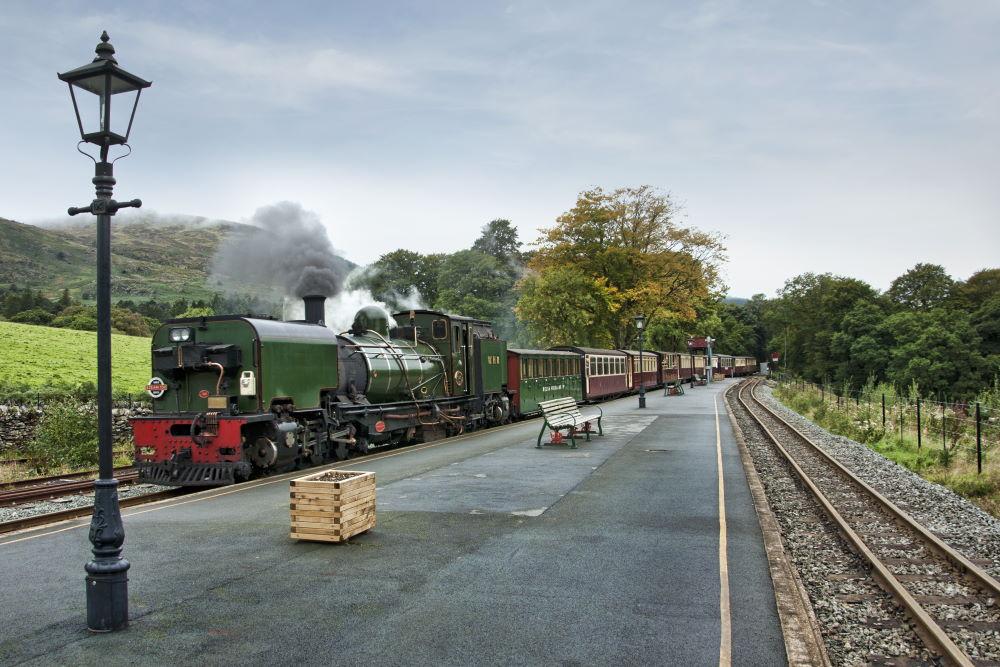 The Beyer Garratt locomotive on the Welsh Highland Railway at Beddgelet station in Snowdonia Wales