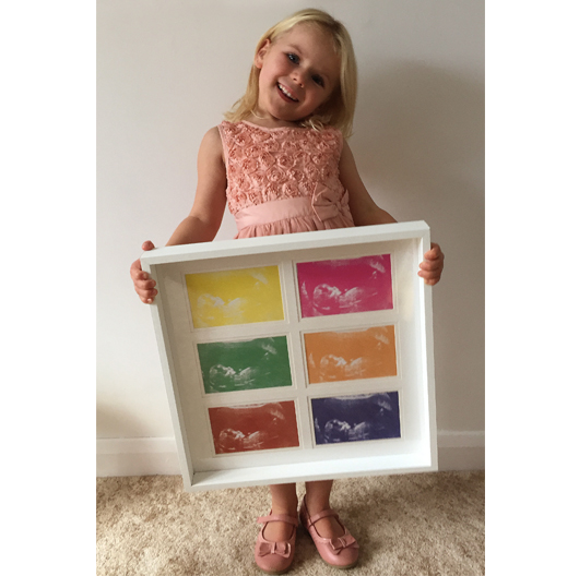 Gorgeous 4 year old Layla, showing off her Scan Collage. Her parents chose our 'bright' colour range.
