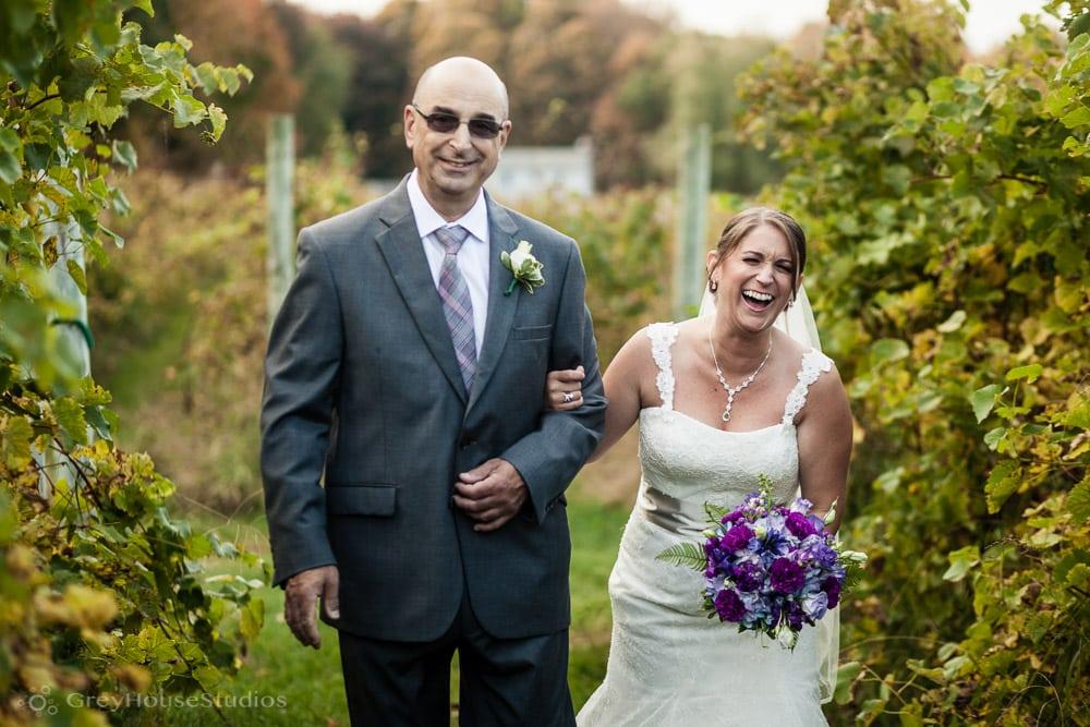 priam vineyards wedding photos bride and father walking through vineyard