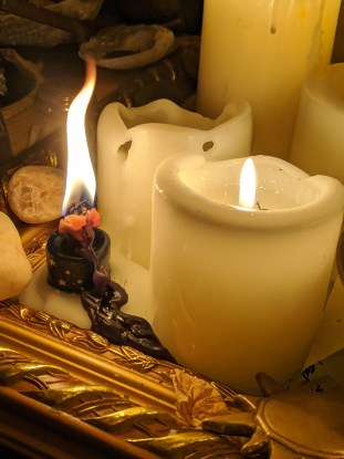 Spell candle with curled flame and wax spillage.