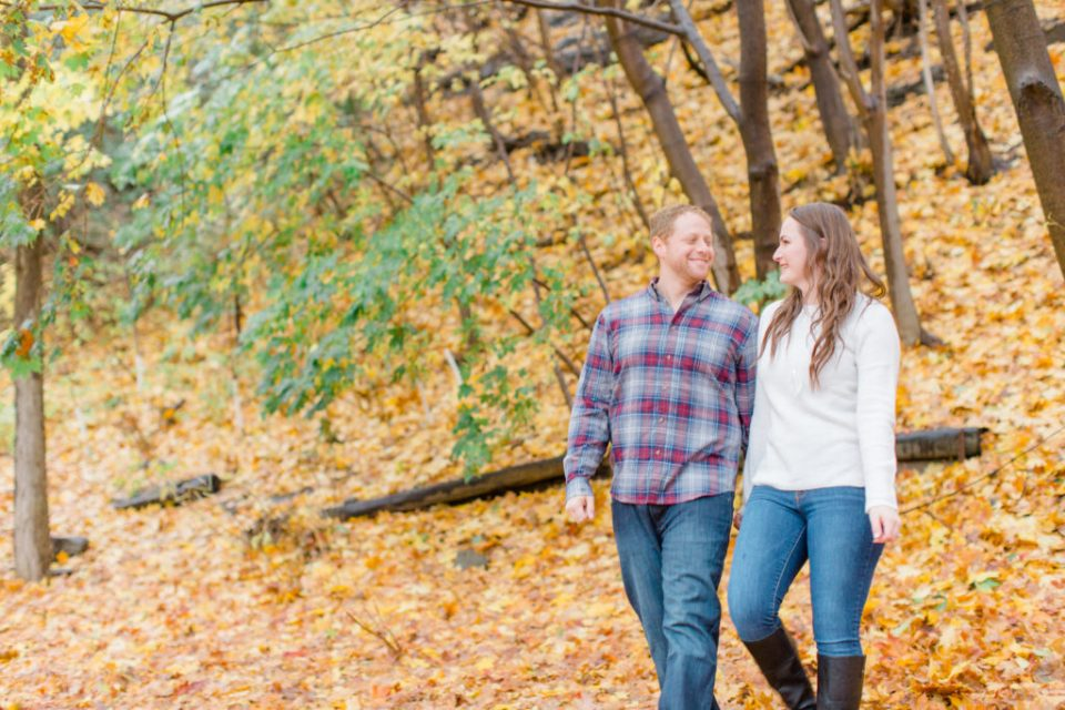 couple walking together in the rain during the fall  Grey Loft Studio - Ottawa Wedding Photographer & Videographer
