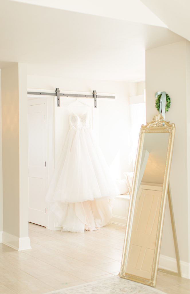 Wedding Dress Hanging in Bridal Suite - Stonefields Weddings and Events Interior - Ottawa Wedding Venue - Modern & Rustic Wedding Venue