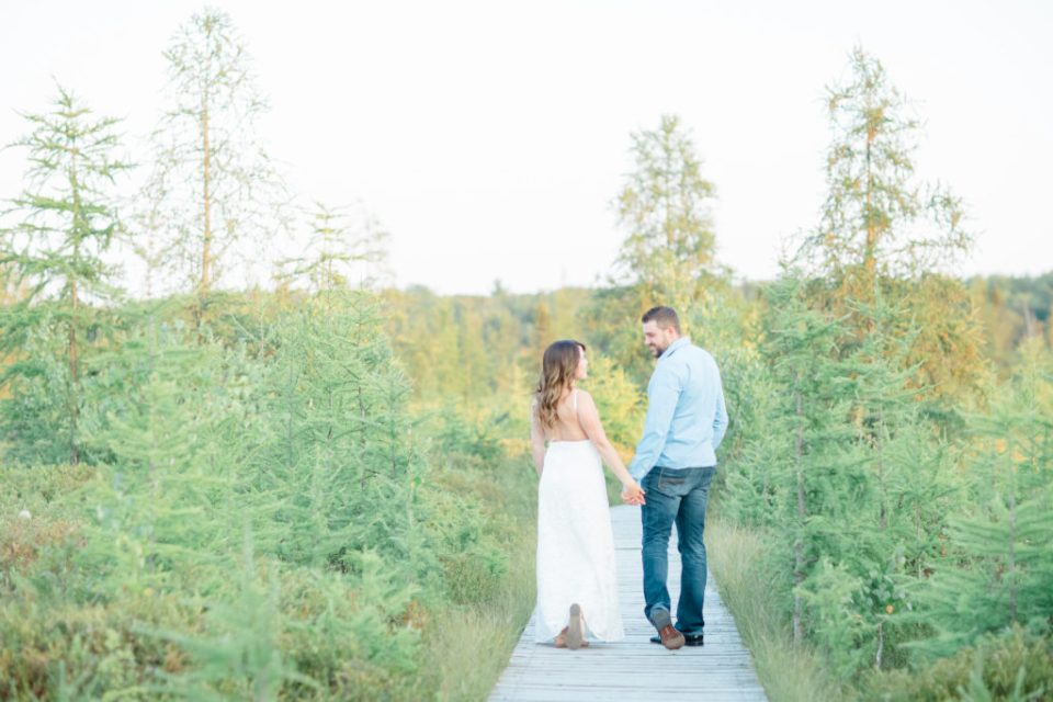 mer bleue bog engagement session in the fall backless white dress and blue dress shirt on the guy with jeans fall colour engagement session romantic engagement grey loft studio ottawa wedding photographer videographer