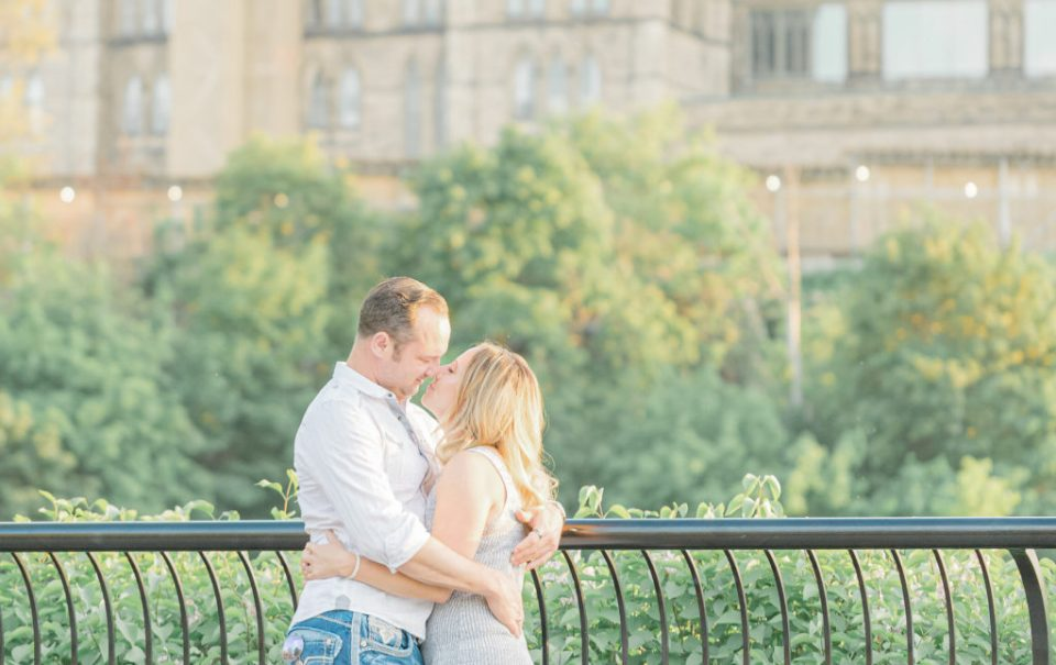 Grey loft studio wedding photographer ottawa wedding videographer ottawa wedding photographer kanata bright and airy true to colour photography couple dancing and kissing in front of parliament hill