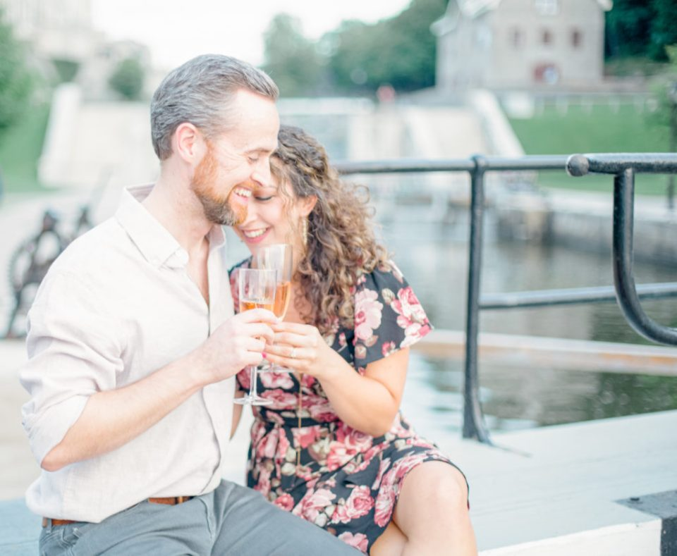 Summer Engagement Session Downtown Ottawa during Sunset National Art Gallery grey loft studio ottawa wedding photographer videographer engagement kanata orleans nepean beautiful locations for engagement photos in ottawa chateau laurier majors hill park pop champagne pink and black dress