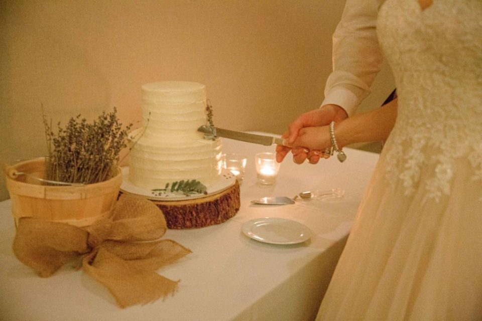 Bride and Groom cutting Cake - Lavender Rain Inspired Wedding - Le Belvedere