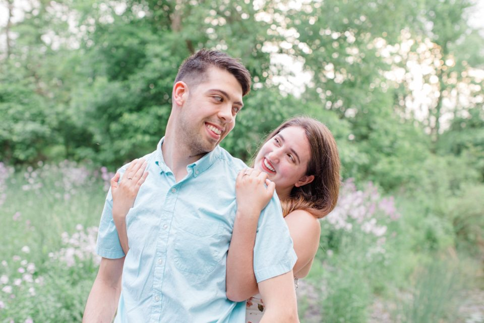Ideas for what to wear for Engagement Photography, Modern Engagement Session Inspiration Wardrobe Ideas. Unsure of what to wear for your engagement photos, we've got you! Romantic white with Pink Flower dress for Spring Engagement in Ottawa. Grey Loft Studio is Ottawa's Wedding and Engagement Photographer for Real couples, showcasing photos that are modern, bright, and fun.