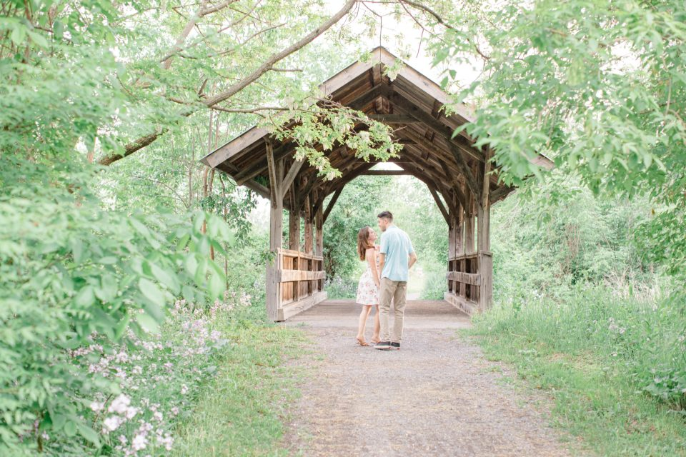 Beautiful Engagement Session Inspo. Ideas for what to wear for Engagement Photography, Modern Engagement Session Inspiration Wardrobe Ideas. Unsure of what to wear for your engagement photos, we've got you! Romantic white with Pink Flower dress for Spring Engagement in Ottawa. Grey Loft Studio is Ottawa's Wedding and Engagement Photographer for Real couples, showcasing photos that are modern, bright, and fun.