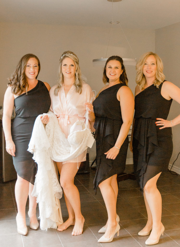 Black Bridesmaids Dress-Flattering curves - Bride and Mother - Doing up Dress Shots - Bride getting Ready Photos - Romantic Wedding at NeXt in Stittsville - Grey Loft Studio - Ottawa Wedding Photographer - Ottawa Wedding Photo & Video Team