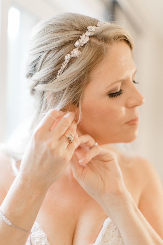 Bride getting Ready Photos -Bride putting on Earrings- Makeup Artist - Romantic Wedding at NeXt in Stittsville - Grey Loft Studio - Ottawa Wedding Photographer - Ottawa Wedding Photo & Video Team