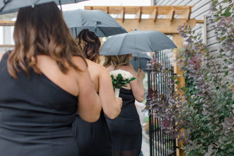 Bridesmaids walking in the Rain - Black Dresses