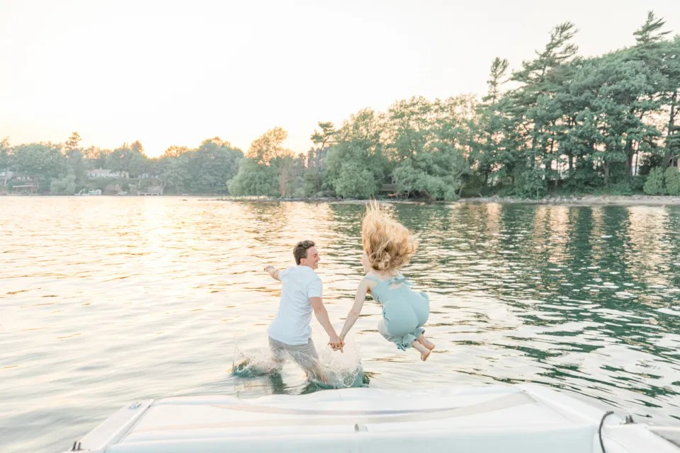 Boat Rides - Ideas for what to wear for Engagement Photography, Modern Engagement Session Inspiration Wardrobe Ideas. Unsure of what to wear for your engagement photos, we've got you! Romantic blue Romper and neutral Shirts and polo. Boat Shoes and Flip Flops. Engagement in Gananoque. Grey Loft Studio is Ottawa's Wedding and Engagement Photographer Videographer for Real couples, showcasing photos that are modern, bright, and fun.