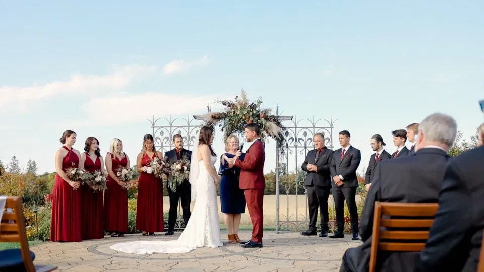 Bride and Groom standing at the Ceremony Site - Evermore Wedding and Events - Blue Sky, Fall Wedding. Grey Loft Studio Photography & Videography Ottawa