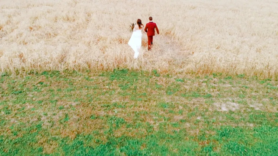 Bride and Groom Running into Field of Wheat. Off-White, Silver, Greenery. Eucalyptus Leaves. An inspiration filled with soft neutrals, lush florals, and layers of romantic textures all set at Evermore Weddings and Events, Almonte Ontario.  Grey Loft Studio shot with Canon 5D Mark 4. Ottawa Wedding Photographer & Videographer Team.