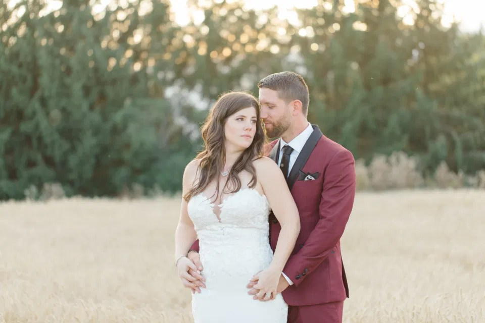 Holding Hands - Bride and Groom Posing at Sunset - Evermore Wedding and Events, Almonte - Bright, Modern, and Fun Wedding Photography. Grey Loft Studio . Wedding Photographer Ottawa.