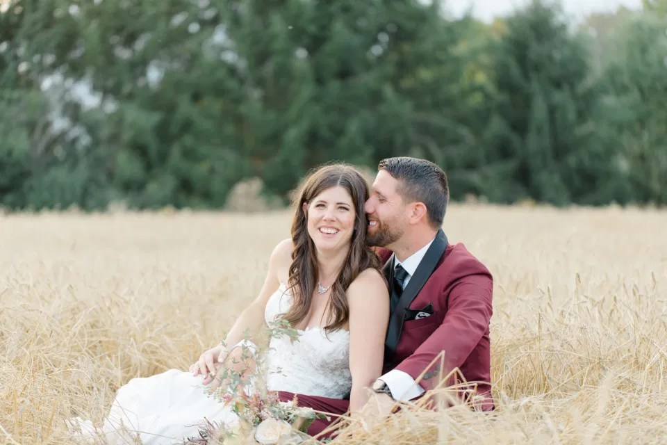 Sitting in a Wheat Field - Holding Hands - Bride and Groom Posing at Sunset - Evermore Wedding and Events, Almonte - Bright, Modern, and Fun Wedding Photography. Grey Loft Studio . Wedding Photographer Ottawa.