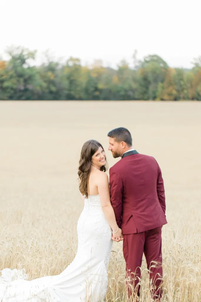 Standing in a Wheat Field - Sitting in a Wheat Field - Holding Hands - Bride and Groom Posing at Sunset - Evermore Wedding and Events, Almonte - Bright, Modern, and Fun Wedding Photography. Grey Loft Studio . Wedding Photographer Ottawa.