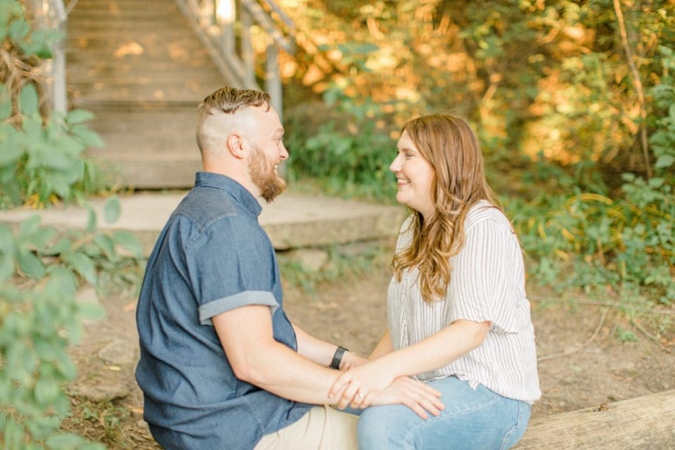 sitting on a log - fun times during engagement session