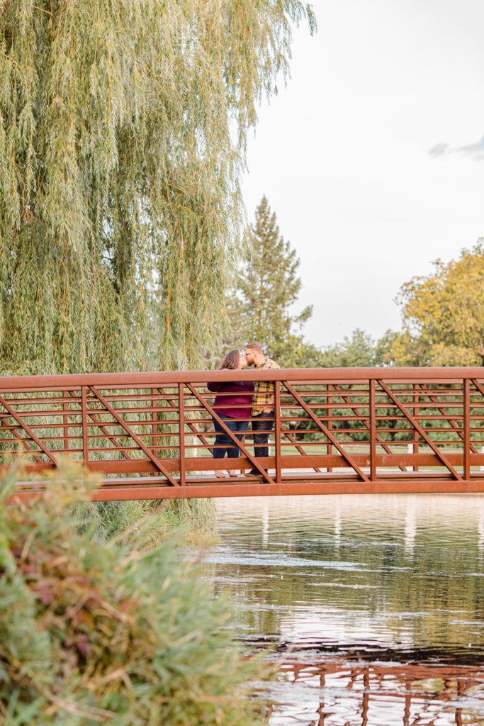 Cute pose on Bridge-Fall Session - Engagement Session - Ottawa Wedding Photographer - Grey Loft Studio - Wedding in Ottawa - Yellow & Plaid with Burgundy Knit Sweater and Jeans - Ottawa Photography Spots - Photographer Needed Ottawa  - Ottawa Camera Traffic - Ottawa Photographers Wedding - photographer in Ottawa