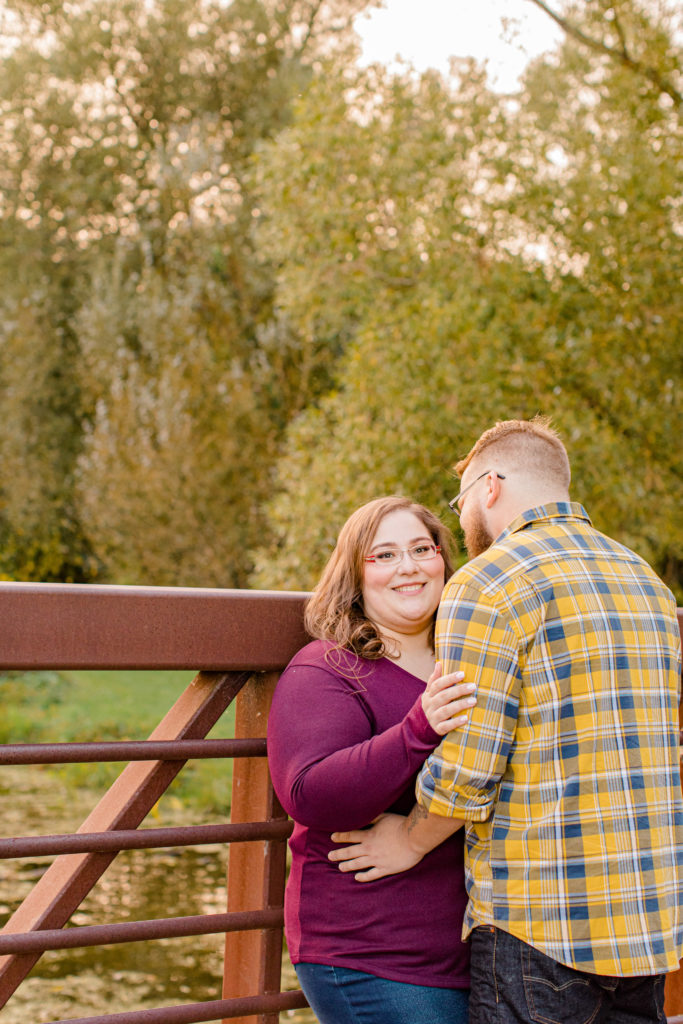 Cute pose on the Bridge - Engagement Session - Ottawa Wedding Photographer - Grey Loft Studio - Wedding in Ottawa - Yellow & Plaid with Burgundy Knit Sweater and Jeans - Photographe