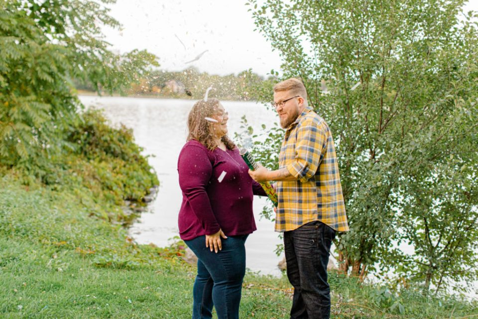 Confetti Kiss during an Engagement Session - Ottawa Wedding Photographer - Grey Loft Studio - Wedding in Ottawa - Smoke Bombs & Confetti during Photo Session Yellow & Plaid with Burgundy Knit Sweater and Jeans