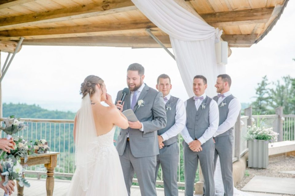 Bride & Groom saying emotional vows to each other at Le Belvedere in Wakefield Quebec. Bride & Groom Preparation for Wedding.  Grey Loft Studio - Ottawa Wedding Photographer - Ottawa Wedding Videographer -Lavender and Grey with neutral florals.
