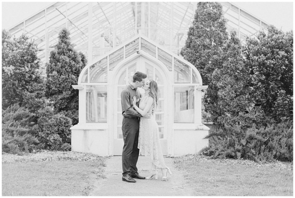 Cute couple having fun! Engagement Photo Poses & ideas - during Engagement Session Ottawa - at the Arboretum in Ottawa.  Pink & Grey, taupe heels, florals, and a charcuterie board. Grey Loft Studio Wedding Photographers & Videographers. BW Photos