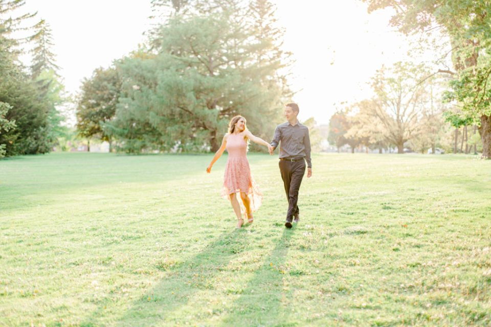 Swinging around together - Dance Poses - Pose Ideas for Photos - Couple Photo Ideas - Cute couple having fun! Engagement Photo Poses & ideas - during Engagement Session Ottawa - at the Arboretum in Ottawa.