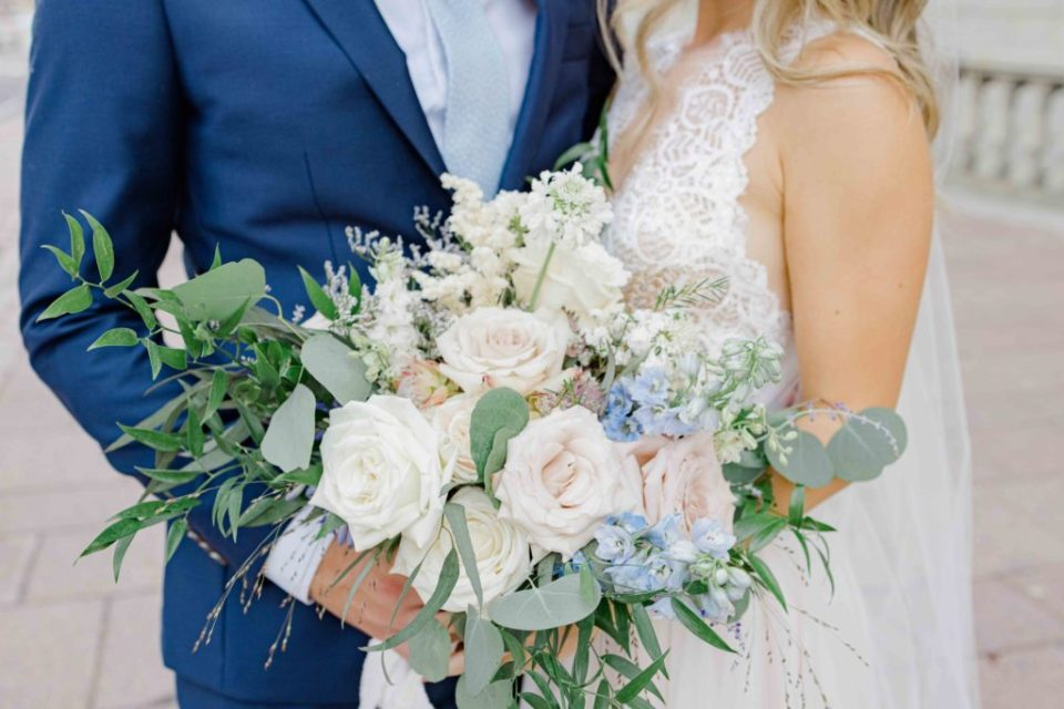 Must have Bouquet Shot at your Wedding - Blue Suit, big floral bouquet, beautiful braided & curled hair. Grey Loft Studio -Ottawa Wedding Photographer