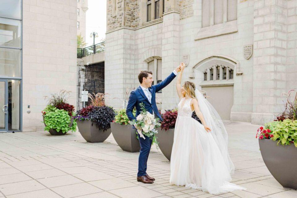 Blue Suit, big floral bouquet, beautiful braided & curled hair. Grey Loft Studio -Ottawa Wedding Photographer