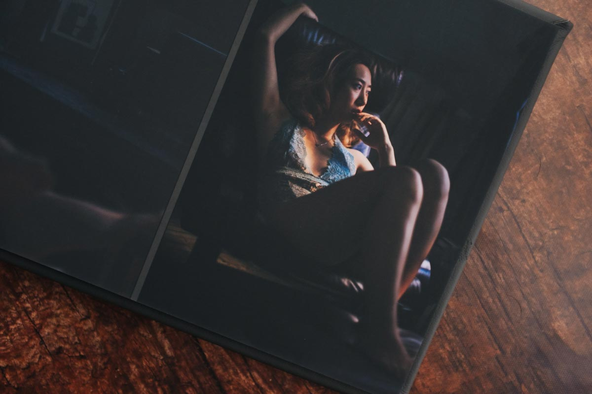 Open view of Boudoir Album with matte Acrylic Cover. Pages are printed on a luster finish. Twin Cities Boudoir Photographer