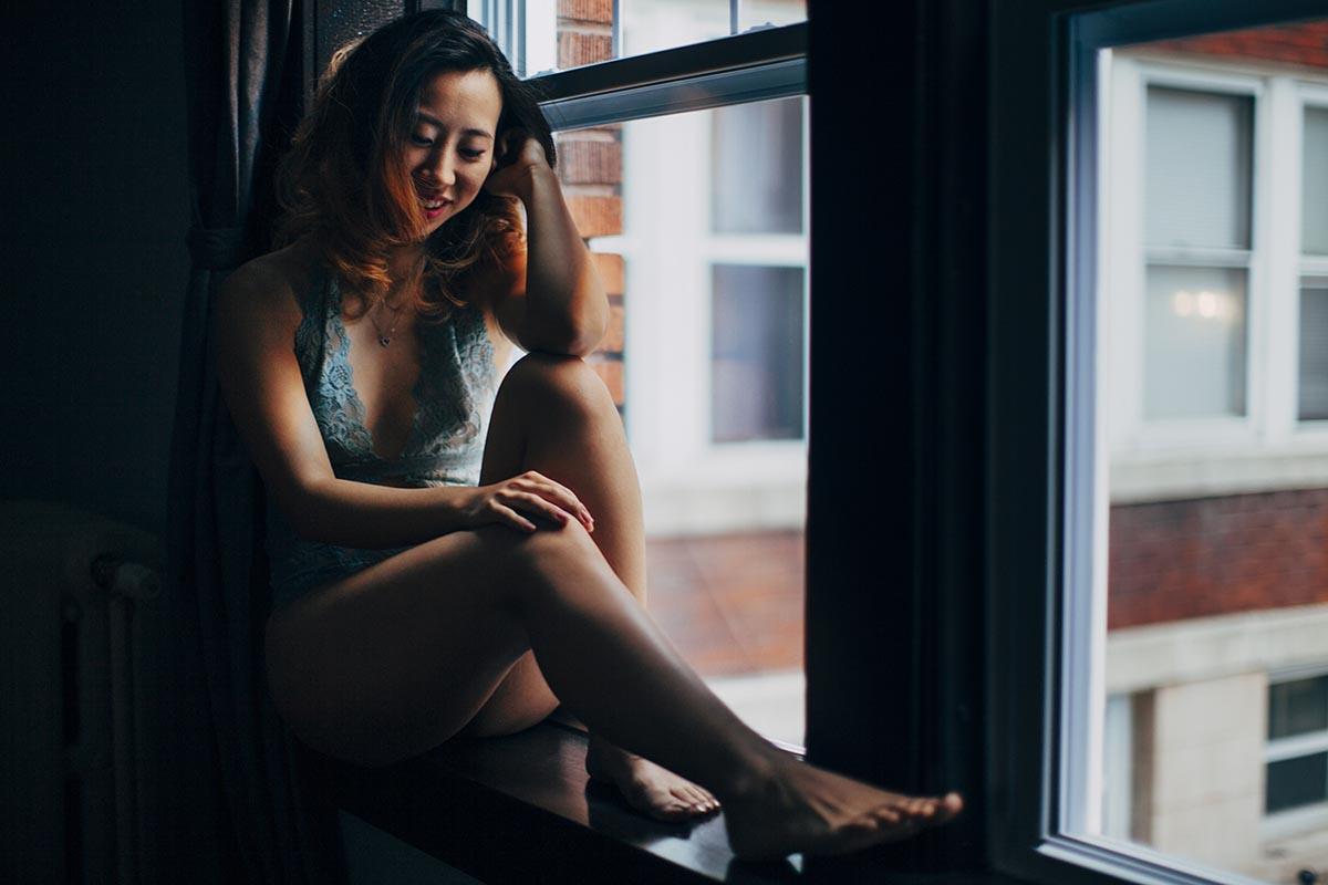 Woman sitting in window Minnesota Intimate Portrait Photographer Fun Candid