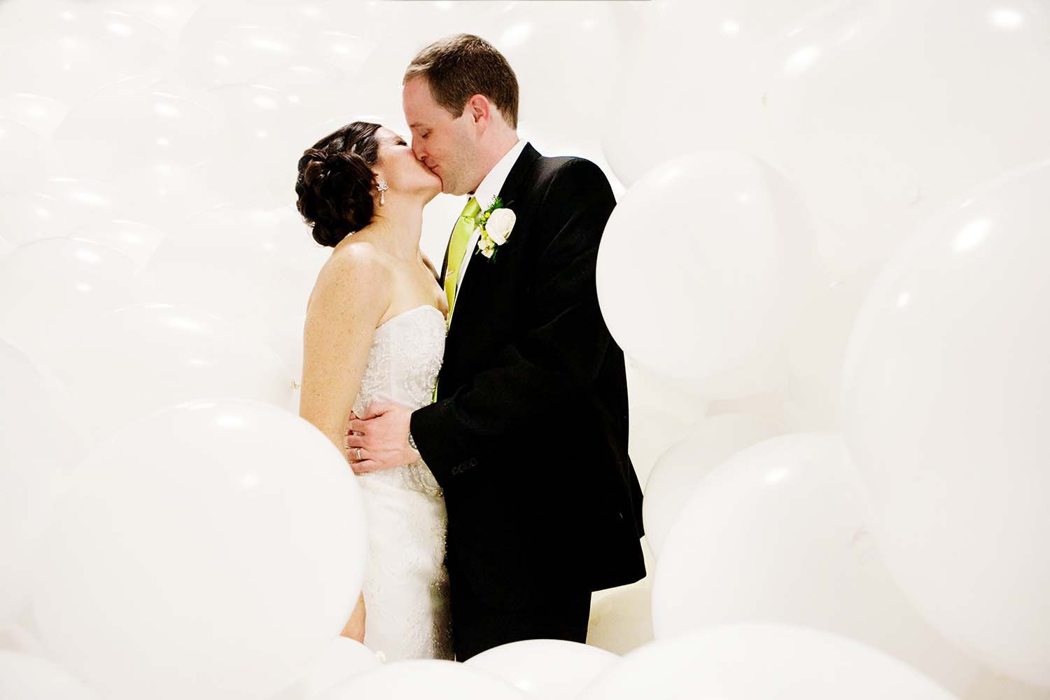 Garfield Park Conservatory White Balloons Kissing Bride Groom