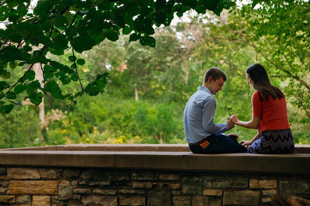 Minnehaha Falls Engagement Photography Couple Sitting Stone Bridge Photojournalist