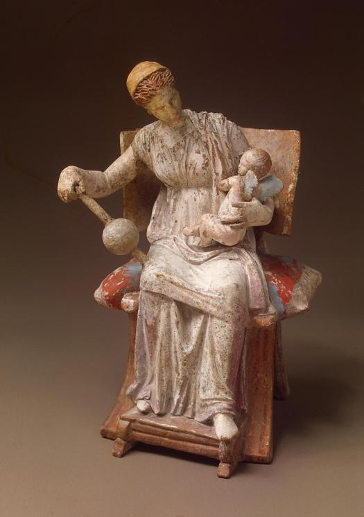 Aphrodite playing with baby Eros, Tanagra Figurine of late 4th century BC, terracotta. This remarkable work of ancient Greek art still retains much of its original coloring intact.  .jpg