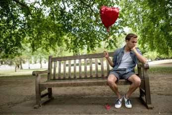 bereaved man with a balloon
