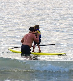 Big paddle boarder, small passenger