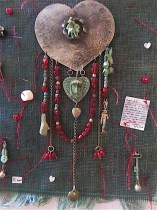 """""""End of the love affair"""" picture brooch on wall hanging."""